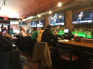 Fans watch the Eagles Super Bowl parade at a Philly bar in Hell's Kitchen, New York.